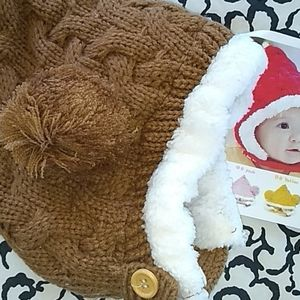 Cute brown pom pom peaked baby hat